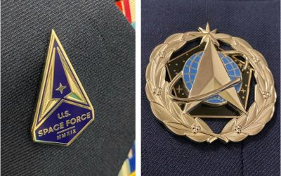 Space Force troops get lapel pin and badge to wear on their Air Force uniforms for now
