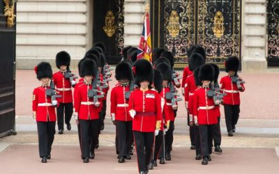 Why do the queen's guards wear such tall hats?